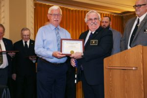 Paul Friend receiving the Order of Service to Masonry from the Grand Lodge